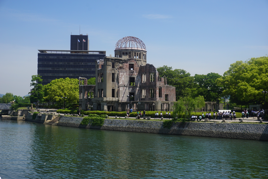 The atomic bomb dome left standing on the peaceful river bank.